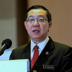 Finance Minister Lim Guan Eng speaks at the signing of a memorandum of understanding between SME Bank, Malaysia Rail Link Sdn Bhd and China Communications Construction (ECRL) today. — Bernama