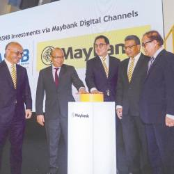 Maybank Group CEO (community financial services) Datuk John Chong, PNB president and group CEO Datuk Abdul Rahman Ahmad, Abdul Farid, Hamirullah and ASNB CEO Mohammad Hussin during the launch today. - AMIRUL SYAFIQ BIN MOHD DIN/THESUN