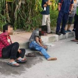 The two suspects, after they were beaten up at Jalan Bukit Minyak, on April 19, 2019.