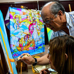 Ecuadorean artist Ivan Delgado and his students work on panels that will be part of a giant mural, that will backdrop Pope Francis' mass during the World Youth Day, in Panama City on December 27, 2018 — AFP
