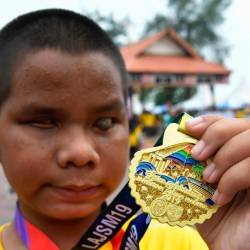 Adam Zakaria Mohd Fakhruddin poses with his medal at the Sultan Mahmud Bridge International Run 2019, on Sept 14, 2019. — Bernama