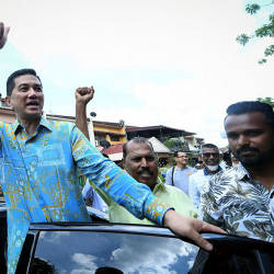 Datuk Seri Azmin Ali is greeted by supporters during the Gombak Setia constituency's Aidilfitri do, on June 16, 2019. — Bernama