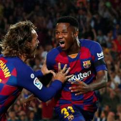 Barcelona's Anssumane Fati celebrates scoring his first goal with Antoine Griezmann, during the FC Barcelona v Valencia game at Camp Nou, Barcelona, Spain on September 14, 2019. - Reuters