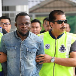 The suspect being led out of the Sepang magistrate's court, on May 24, 2019. — Bernama