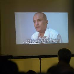This file photo taken March 29, 2016 shows Pakistani journalists watching a video showing Indian national Kulbhushan Jhadav, arrested on suspicion of spying, during a press conference in Islamabad. — AFP