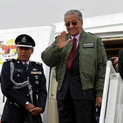 Prime Minister Tun Dr Mahathir Mohamad waves to the crowd before departing to return to Malaysia after his three-day official visit to Pakistan.— Bernama