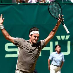 Roger Federer from Switzerland reacts after he won his final match against David Goffin from Belgium at the ATP tennis tournament in Halle, western Germany, on June 23, 2019. — AFP