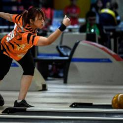 National kegler Siti Safiyah Amirah Abdul Rahman takes part in the stepladder women's masters gold medal bowling event at the Coronado Lanes, Starmall EDSA, Manila. - Bernama