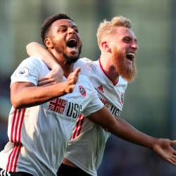 Sheffield United's Lys Mousset celebrates scoring their second goal with Oliver McBurnie. - Reuters