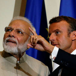 French President Emmanuel Macron gestures as Indian Prime Minister Narendra Modi looks on (L) after their joint statement following a meeting at the Chateau of Chantilly on Aug 22, 2019, near Paris. — AFP