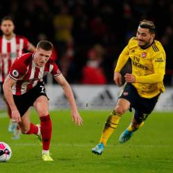 Sheffield United's John Lundstram in action with Arsenal's Sead Kolasinac during the Premier League match between Sheffield United and Arsenal at Bramall Lane, Sheffield, Britain on October 21, 2019. - Reuters