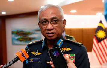 Chief of Defence Forces Gen Tan Sri Affendi Buang speaks to the press after receiving a donation of PPE for use by frontline personnel from PT Bayan Resources at Wisma Pertahanan today. - Bernama