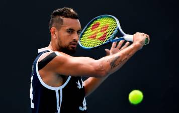 Nick Kyrgios of Australia hits a return during a practice session ahead of the Australia Open tennis tournament in Melbourne on January 18, 2020. - AFP