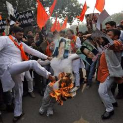Activists from Hindu Sena, burn an effigy depicting Pakistan's Prime Minister Imran Khan during a protest against the attack on a bus that killed 44 police personnel in Kashmir, in New Delhi, India, on Feb 15, 2019. — Reuters