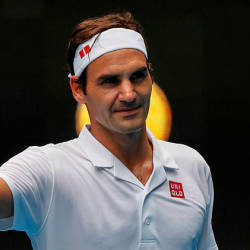 Switzerland's Roger Federer celebrates after victory over Britain's Daniel Evans in their men's singles match on day three of the Australian Open tennis tournament — AFP