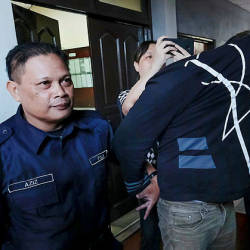 Muhammad Firdaus Naim Thikayarajan was charged at the Ipoh Magistrate's Court for murdering a man three years ago. — Bernama