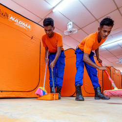 Members of the Civil Defence Force prepare the temporary shelter for the Orang Asli settlers in Gua Musang, on June 15, 2019. — Bernama