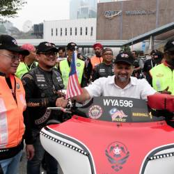 Communications and Multimedia Minister Gobind Singh Deo tries out a high-powered bike during the flagging-off ceremony of the Kingz Annual Ride (KAR) to forge greater unity among themselves and promote healthy living through the motorsport activity, on Sept 13, 2019. — Bernama