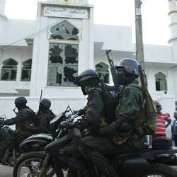 Heavily-armed Sri Lankan soldiers ride a motorcycle in front of the Jumha Mosque after a mob attack in Minuwangida on May 14, 2019. - AFP