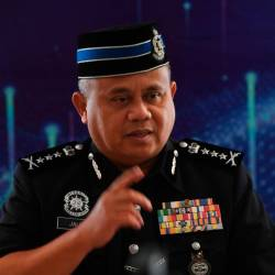 Pahang police chief Datuk Abdul Jalil Hassan answers questions at a press conference after Pahang police contingent's medal award ceremony held in Kuantan today. - Bernama