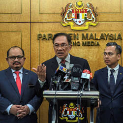PKR president Datuk Seri Anwar Ibrahim at a press conference in parliament yesterday. — Bernama