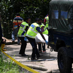Police carry the remains of a man was found in the Paya Bungor Lake at the 50th Kilometre Kuantan-Maran Road with both his hands and feet tied, on Oct 20, 2019. — Bernama