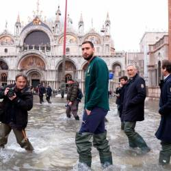 AC Milan's goalkeeper Gianluigi Donnarumma walks in St Mark square on November 16, 2019 in Venice, three days after the city suffered the highest tide in 50 years. - AFP