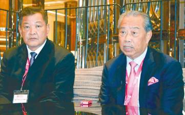 Home Minister Tan Sri Muhyiddin Yassin says no permission was given for Chin Peng's ashes to be brought to Malaysia. He was in Bangkok on Nov 27 with IGP Tan Sri Abdul Hamid Bador when he made the statement. – Bernamapix