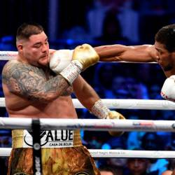 British boxer Anthony Joshua (white trunks) competes with Mexican-American boxer Andy Ruiz Jr (golden trunks) during the heavyweight boxing match between Andy Ruiz Jr. and Anthony Joshua for the IBF, WBA, WBO and IBO titles in Diriya, near the Saudi capital on December 7, 2019. - AFP