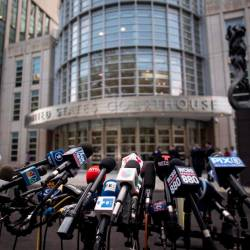 In this file photo taken on July 17, microphones are set up outside Brooklyn Federal Court for Mexican drug lord Joaquin El Chapo Guzman's sentencing, in New York. — AFP