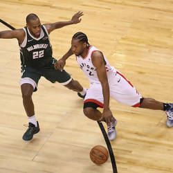 Toronto Raptors forward Kawhi Leonard (2) dribbles the ball in the fourth quarter as Milwaukee Bucks forward Khris Middleton (22) defends in game three of the Eastern conference finals of the 2019 NBA Playoffs at Scotiabank Arena. - Reuters