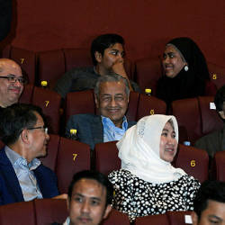Prime Minister Tun Dr Mahathir Mohamad and wife, Tun Dr Siti Hasmah Mohd Ali react while watching the animated movie Ejen Ali The Movie at GSC Pavillion last night. — Bernama
