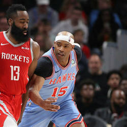 Houston Rockets guard James Harden (13) is fouled by Atlanta Hawks forward Vince Carter (15) in the second half at State Farm Arena — Reuters