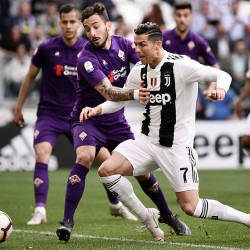 Fiorentina Federico Ceccherini (L) holds off Juventus' Cristiano Ronaldo during their Serie A match on April 20, 2019 at the Juventus stadium in Turin. — AFP