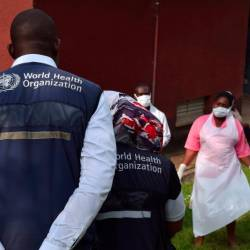 World Health Organization (WHO) officials talk to Ugandan medical staff as they inspect ebola preparedness facilities at the Bwera general hospital near the border with the Democratic Republic of Congo in Bwera, Uganda. — Reuters