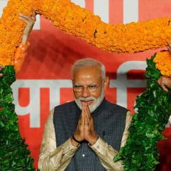 Indian Prime Minister Narendra Modi gestures as he is presented with a garland by Bharatiya Janata Party (BJP) leaders after the election results in New Delhi, India, May 23, 2019. - Reuters