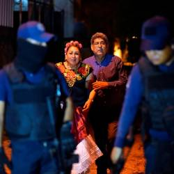 People react next to police officers guarding a crime scene where unidentified assailants opened fire at a bar in Minatitlan, in Veracruz state, Mexico, April 19, 2019. — Reuters
