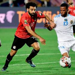 Egypt's forward Mohamed Salah (L) fights for the ball with DR Congo's forward Elia Meschak during the 2019 Africa Cup of Nations (CAN) football match between Egypt and DR Congo at the Cairo International Stadium on June 26, 2019. — AFP