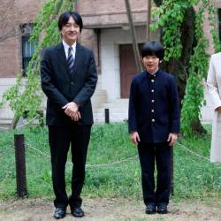 File photo taken on April 8 shows Prince Hisahito, accompanied by his parents Prince Akishino and Princess Kiko, poses for photos at Ochanomizu University junior high school before attending the entrance ceremony in Tokyo, Japan. — Reuters