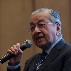"Prime Minister Tun Dr Mahathir Mohamad during a question-and-answer session at the Isis Malaysia Praxis Conference ""Malaysia Beyond 2020"" on Oct 21, 2019. — Bernama"