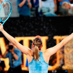 Russia's Maria Sharapova celebrates her victory against Denmark's Caroline Wozniacki after their women's singles match on day five of the Australian Open — AFP