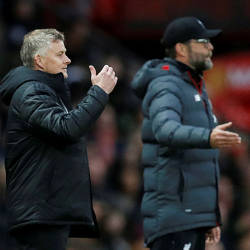 Manchester United manager Ole Gunnar Solskjaer and Liverpool manager Juergen Klopp during the match, October 20, 2019. — Reuters