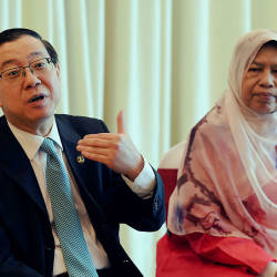 Finance Minister Lim Guan Eng (L), at a joint media conference with Housing and Local Government Minister Zuraida Kamaruddin (R), on Aug 22, 2019. — Bernama