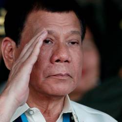 Philippine President Rodrigo Duterte salutes as he takes part during the Armed Forces anniversary celebration at Camp Aguinaldo in Quezon city, Metro Manila Dec 21, 2016. — Reuters