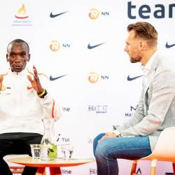 Kenyan athlete Eliud Kipchoge (L) speaks to the press in The Hague, on Oct 15, 2019. — AFP