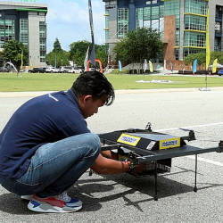 An engineer from Average Drone Sdn Bhd exhibiting the drone used in the food delivery service on June 17 during Multimedia Technology week at Cyberjaya, Sepang. — Bernama