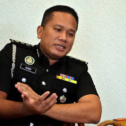 Foreigner claiming to be M'sian nabbed after failing to sing Negaraku