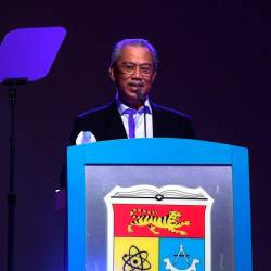 Prime Minister Tan Sri Muhyiddin Yassin addressing his speech at the Launching Ceremony of the The Ministry of Higher Education-Career Advancement Programme (KPT-CAP) Economic Recovery Plan (PENJANA) at the Universiti Kebangsaan Malaysia (UKM) Tun Abdul Razak Chancellor Hall today. — Bernama
