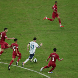 Argentina's Lionel Messi trailed by three Qatari defenders behind, and one in front, during their Copa America Group B game, at Porto Alegre, on June 24, 2019. — AFP
