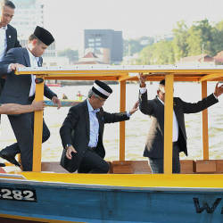 The Yang di-Pertuan Agong Al-Sultan Abdullah Ri'ayatuddin (2nd L) is led into a boat to be taken on a river cruise along the banks of the Brunei River, Kampong Ayer, on Aug 19, 2019. — Bernama